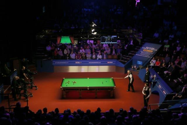 John Higgins at the table during the World Championship at the Crucible in Sheffield.