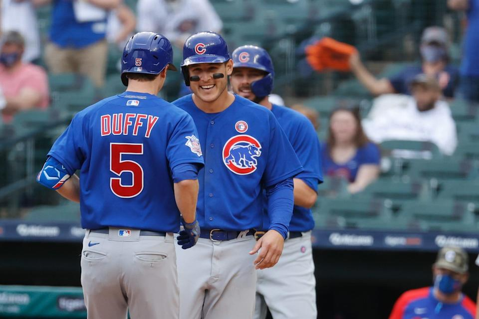 Chicago Cubs third baseman Matt Duffy (5) receives congratulations from first baseman Anthony Rizzo (44) after he hits a three run home run in the fifth inning against the Detroit Tigers at Comerica Park.