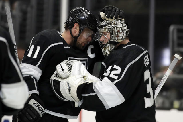 Los Angeles Kings' Anze Kopitar (11) and Jonathan Quick celebrates after a 3-1 win over the Colorado Avalanche during an NHL hockey game Monday, March 9, 2020, in Los Angeles. (AP Photo/Marcio Jose Sanchez)
