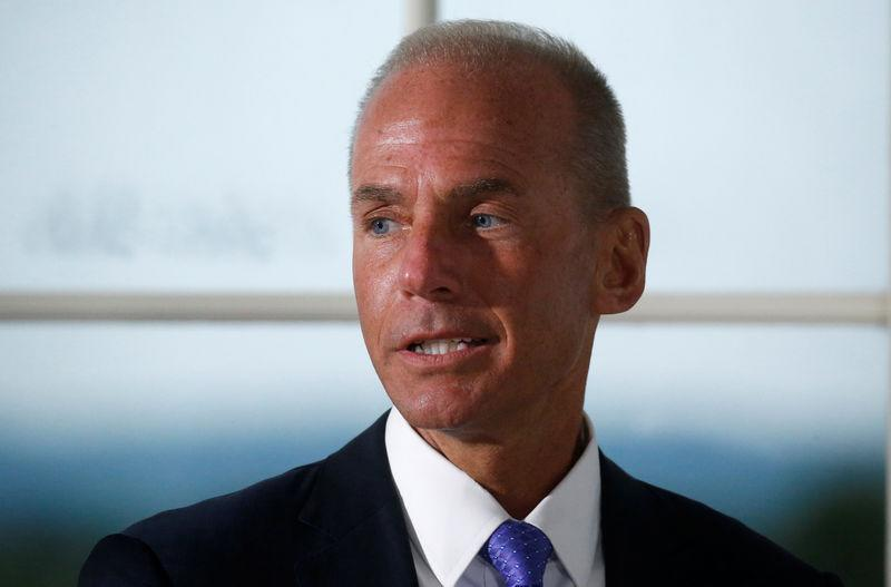 Dennis Muilenburg, president and chief executive officer of The Boeing Company, introduces himself during a dinner with business leaders hosted by U.S. President Donald Trump at Trump National Golf Club in Bedminster