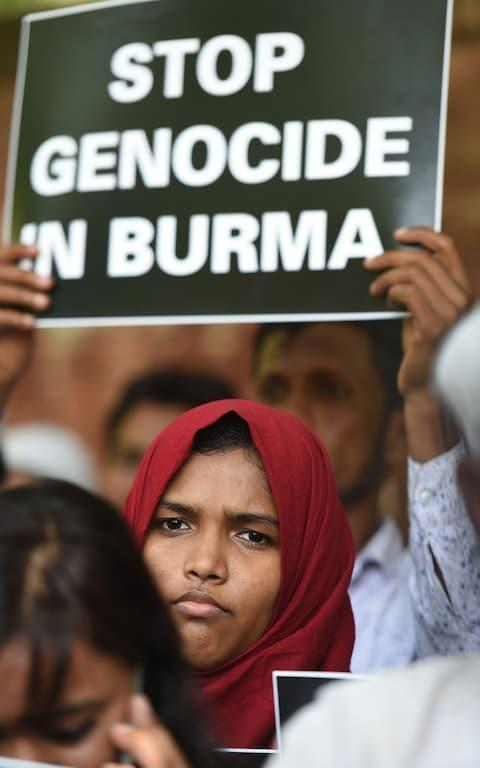 <span>Rohingya Muslim refugees along with Indian supporters hold placards against human rights violations in Myanmar during a protest in New Delhi on September 5, 2017</span> <span>Credit: AFP </span>