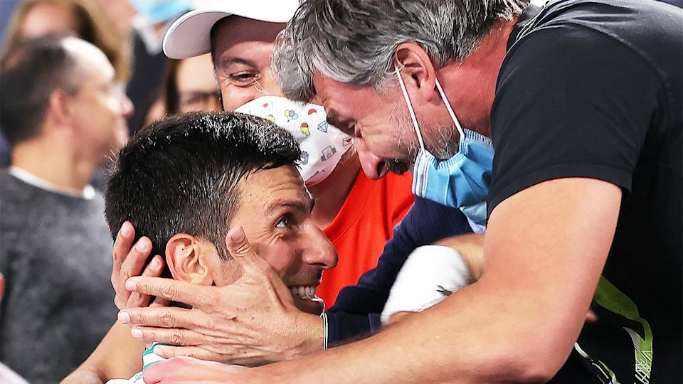 Novak Djokovic (pictured left) celebrates with his coach Goran Ivanisevic (pictured right) at the Australian Open final.
