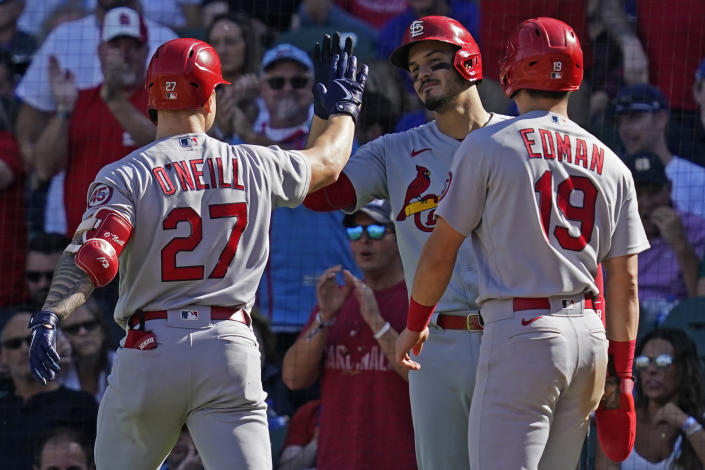 St. Louis Cardinals' Tyler O'Neill, left, celebrates with Nolan Arenado, center, and Tommy Edman after hitting a two-run home run during the fifth inning of a baseball game against the Chicago Cubs in Chicago, Friday, Sept. 24, 2021. (AP Photo/Nam Y. Huh)
