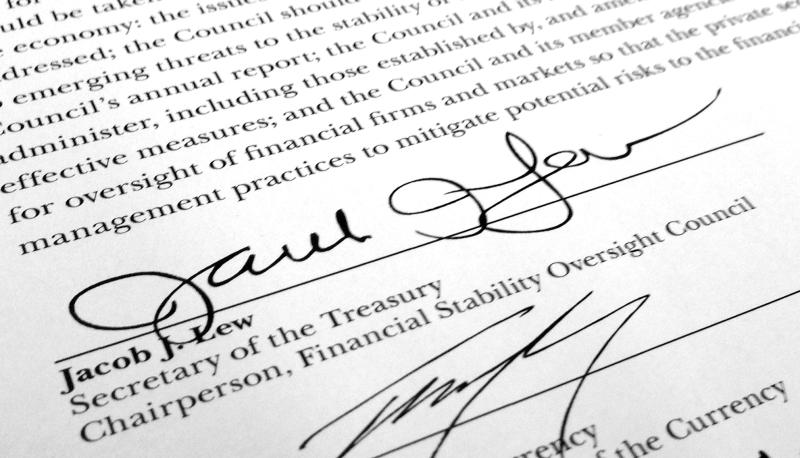 "Treasury Secretary Jacob Lew's signature is shown on the annual report for the Financial Stability Oversight Council in Washington, on Tuesday, May 7, 2013. Lew may not have succeeded yet in getting a grand budget bargain with Congress, but at least his handwriting is improving. And it is expected to be even better when the time comes for him to affix his ""Jacob Lew"" to the nation's currency. President Barack Obama joked in January when he nominated Lew for the Treasury post that he had never noticed before how illegible Lew's signature was. Lew's scrawl as OMB director consisted of a series of loops that bore no resemblance to his name. (AP Photo/Jon Elswick)"