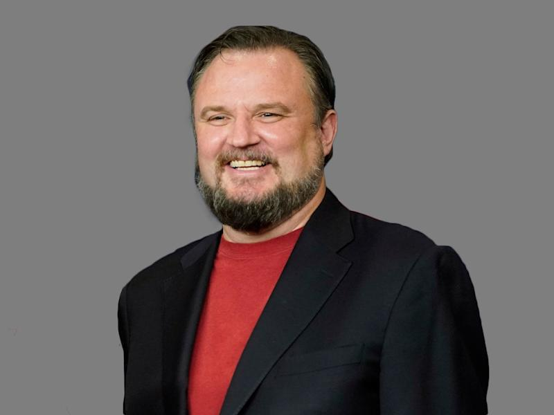Daryl Morey headshot, as Houston Rockets General Manager, graphic element on gray