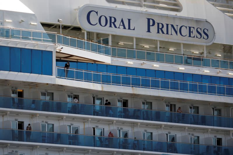 FILE PHOTO: Passengers are seen aboard the Coral Princess ship, of Princess Cruises fleet, with patients affected by coronavirus disease (COVID-19)
