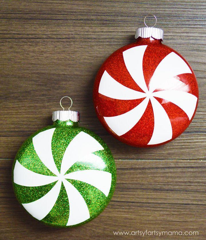 """<p>A heavy hand of glitter and some cleverly cut vinyl come together to make an ornament so sweet you could almost eat it. </p><p><em>Get the tutorial at <a href=""""https://www.artsyfartsymama.com/2014/11/glitter-peppermint-ornaments.html"""" rel=""""nofollow noopener"""" target=""""_blank"""" data-ylk=""""slk:Artsy Fartsy Mama"""" class=""""link rapid-noclick-resp"""">Artsy Fartsy Mama</a>.</em></p><p><a class=""""link rapid-noclick-resp"""" href=""""https://www.amazon.com/Pacon-Spectra-Sparkling-Crystals-91640/dp/B000J07O0A?tag=syn-yahoo-20&ascsubtag=%5Bartid%7C10072.g.34443405%5Bsrc%7Cyahoo-us"""" rel=""""nofollow noopener"""" target=""""_blank"""" data-ylk=""""slk:SHOP RED GLITTER"""">SHOP RED GLITTER</a></p>"""