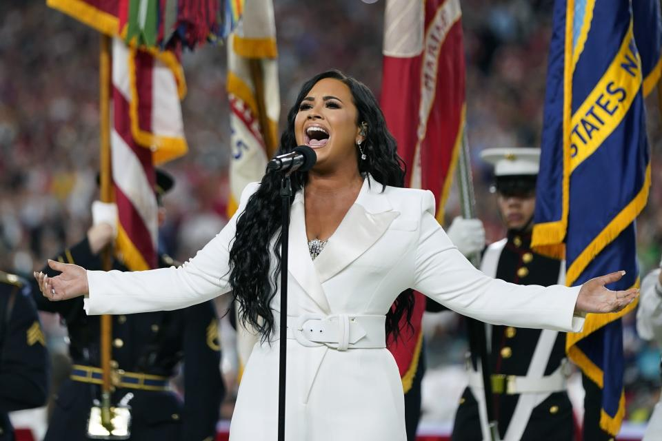 "FILE - Demi Lovato performs the national anthem before the NFL Super Bowl 54 football game between the San Francisco 49ers and the Kansas City Chiefs in Miami Gardens, Fla., on Feb. 2, 2020. Lovato reveals publicly for the first time details about her near-fatal drug overdose in 2018 in ""Demi Lovato: Dancing With the Devil,"" a four-part docuseries debuting March 23, 2021, on YouTube Originals. (AP Photo/David J. Phillip, File)"