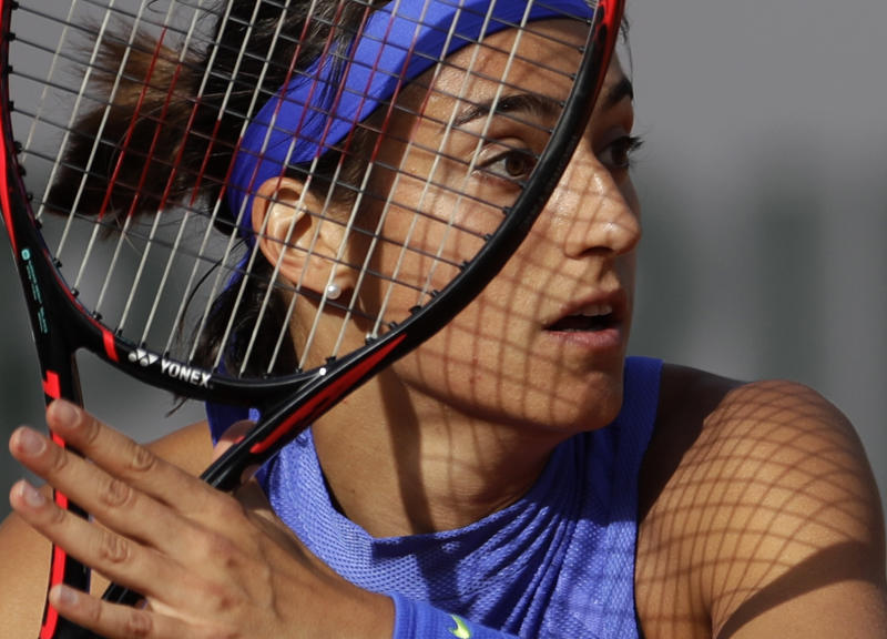 France's Caroline Garcia prepares to return a shot against France's Alize Cornet during their fourth round match of the French Open tennis tournament at the Roland Garros stadium, in Paris, France. Monday, June 5, 2017. (AP Photo/Petr David Josek)