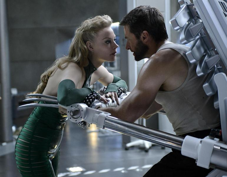 """This publicity image released by 20th Century Fox shows Svetlana Khodchenkova as Viper, left, and Hugh Jackman as Logan in a scene from """"The Wolverine."""" (AP Photo/20th Century Fox, Ben Rothstein)"""