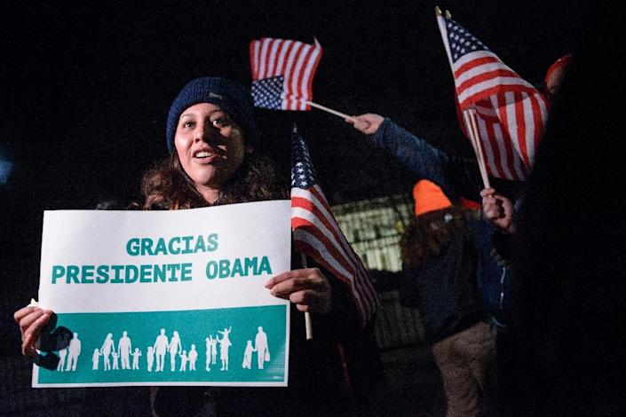Immigration activists celebrate outside the White House on November 20, 2014 in Washington, DC after US President Barack Obama addressed the nation on his immigration plan (AFP Photo/Brendan Smialowski)