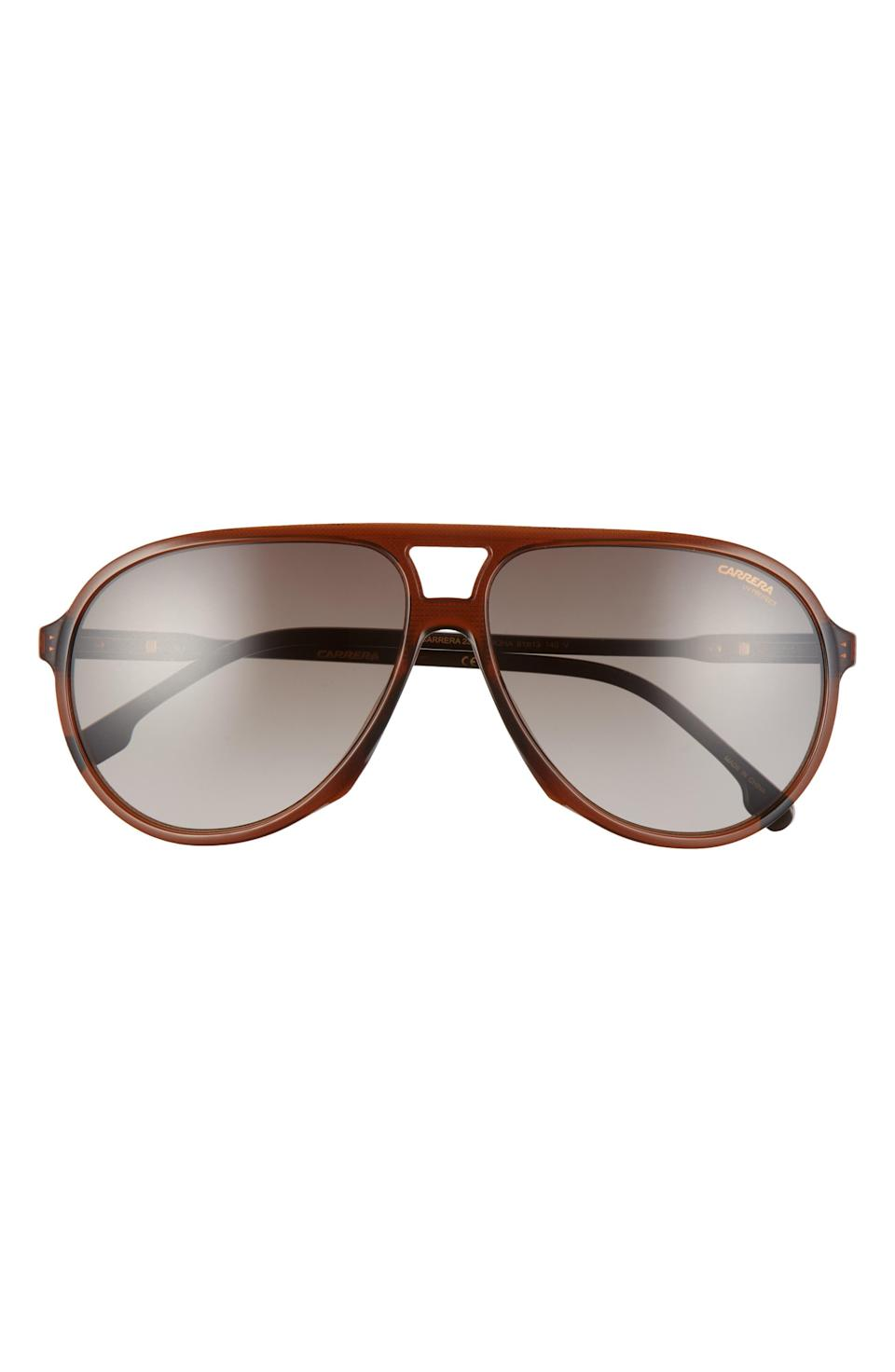 """<p><strong>CARRERA EYEWEAR</strong></p><p>nordstrom.com</p><p><strong>$91.80</strong></p><p><a href=""""https://go.redirectingat.com?id=74968X1596630&url=https%3A%2F%2Fwww.nordstrom.com%2Fs%2Fcarrera-eyewear-61mm-aviator-sunglasses%2F6114090&sref=https%3A%2F%2Fwww.esquire.com%2Fstyle%2Fg36535194%2Fnordstrom-mens-sale-half-yearly-spring-2021%2F"""" rel=""""nofollow noopener"""" target=""""_blank"""" data-ylk=""""slk:Shop Now"""" class=""""link rapid-noclick-resp"""">Shop Now</a></p><p>Meet your new favorite retro-inspired sunglasses, courtesy of Carrera. </p>"""