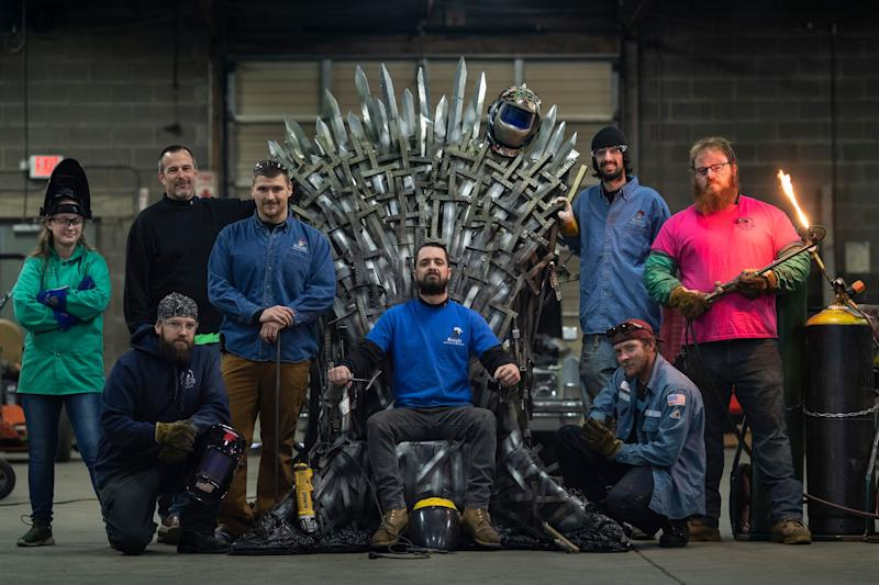 Knight School of Welding student Dayle Gray, from left, owner Matt Hobbs, students Anthony Williams, Kyle Fox, Eddie Knight, Daren Hobbs, Jesse Loghry, and Jeff Smith stand with their full-size replica of the Iron Throne on the Game of Thrones HBO series. Students put in over 100 hours crafting the replica throne out of aluminum to be used as a prop in fellow student and wounded warrior veteran Mike Haye's wedding. April 19, 2019