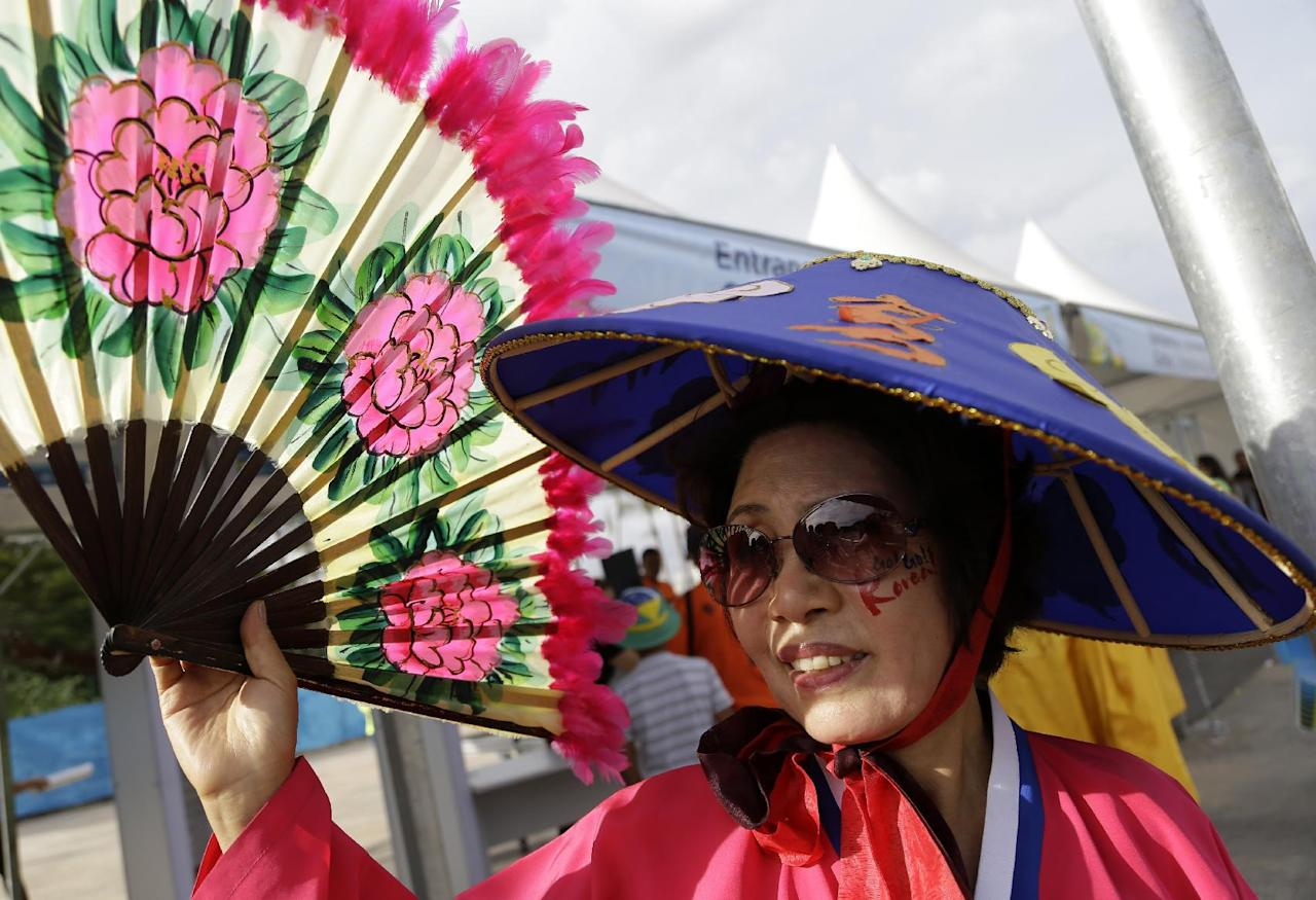 A fan of the South Korean national soccer team arrives to the Arena Pantanal before the group H World Cup soccer match between Russia and South Korea in Cuiaba, Brazil, Tuesday, June 17, 2014. (AP Photo/Thanassis Stavrakis)