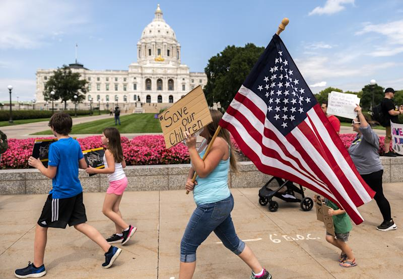 Demonstrators gather outside the Capitol in St. Paul, Minnesota, Aug. 22 to support the Save the Children movement.