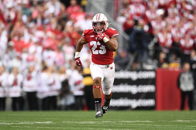 Wisconsin RB Jonathan Taylor pulled away from the Michigan defense on Saturday. (Getty Images)
