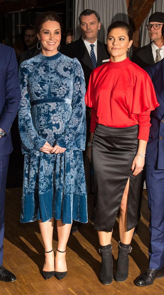 <p>In a surprising fashion move, Crown Princess Victoria chose a red batwing-sleeved blouse by Swedish label Stylein and teamed the look with a thigh-split skirt by the same brand for a trip to the Fotografiska Galleries . The royal finished the look with a pair of Rebecca Björnsdotter ankle boots. <em>[Photo: Getty]</em> </p>