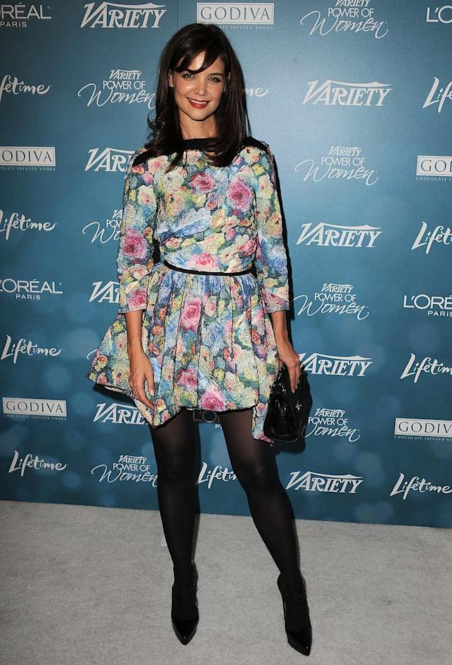 """Perhaps it's just us, but we think Katie Holmes' floral Louis Vuitton frock would look a lot better on one of Suri's creepy dolls ... or in the garbage. Steve Granitz/<a href=""""http://www.wireimage.com"""" target=""""new"""">WireImage.com</a> - September 30, 2010"""