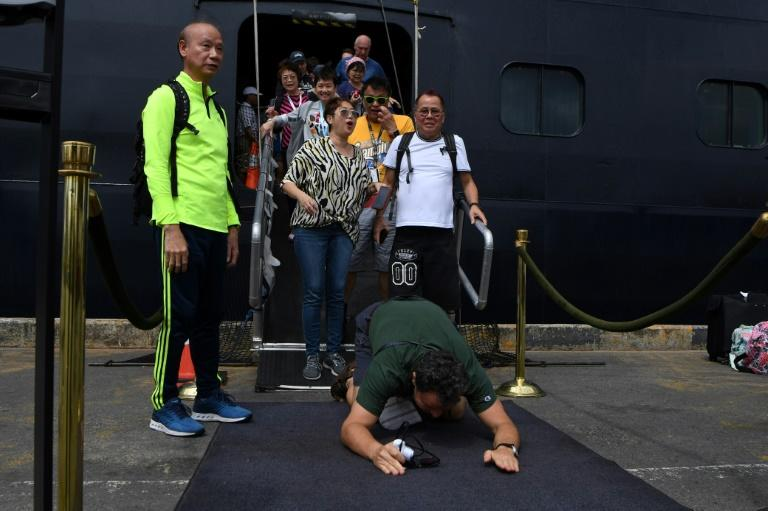 Passengers on the Westerdam were allowed to disembark in Cambodia on Friday after an uncertain two weeks at sea (AFP Photo/TANG CHHIN Sothy)