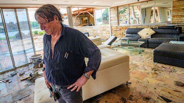 PHOTO: Eric Ehlenberger pauses as he goes through his damaged home in New Orleans on July 10, 2019, following a storm that swamped the city and paralyzed traffic. (Matthew Hinton/AP)