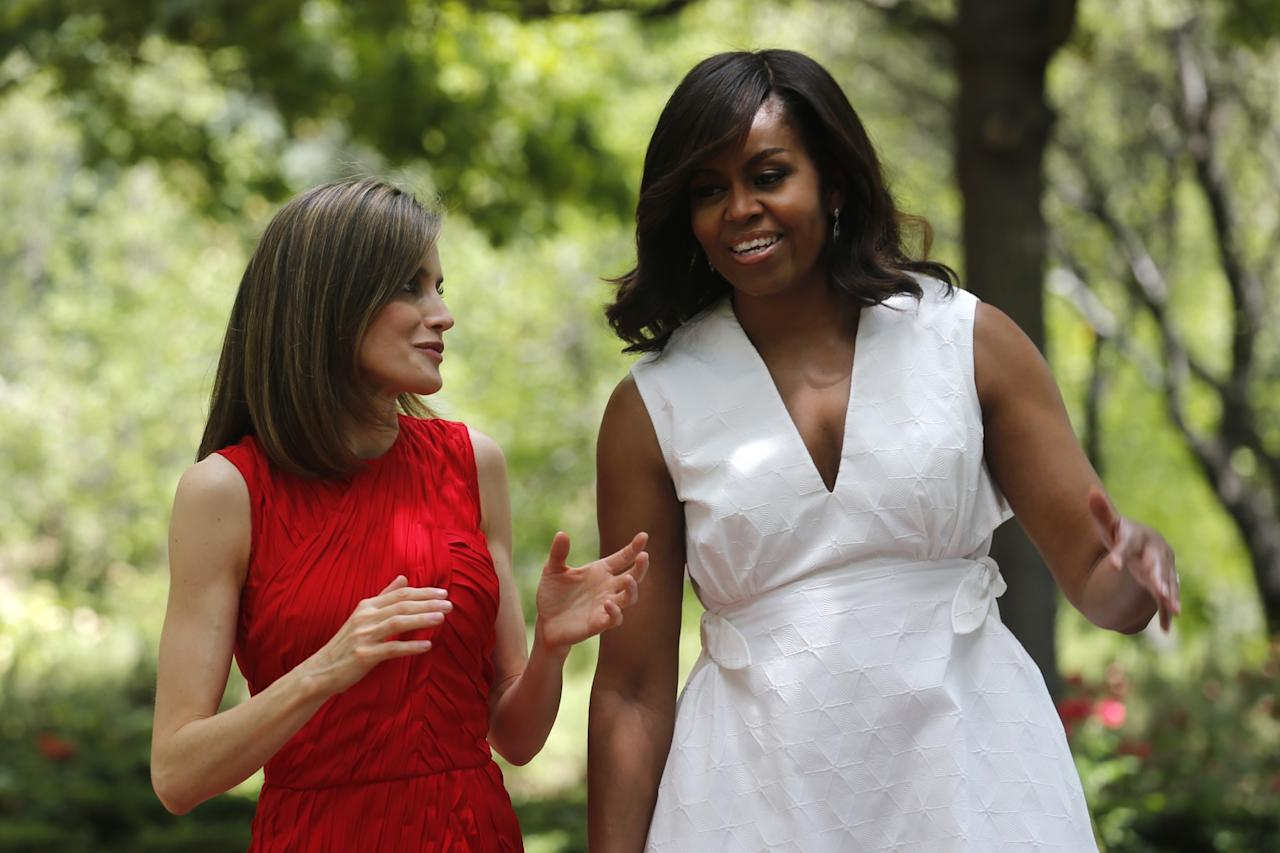<p>U.S. first lady Michelle Obama walks with Spain's Queen Letizia, left, in the gardens of the Zarzuela Palace in Madrid, Spain, Thursday June 30, 2016. (Francisco Gomez, Casa Real Pool Photo via AP) </p>