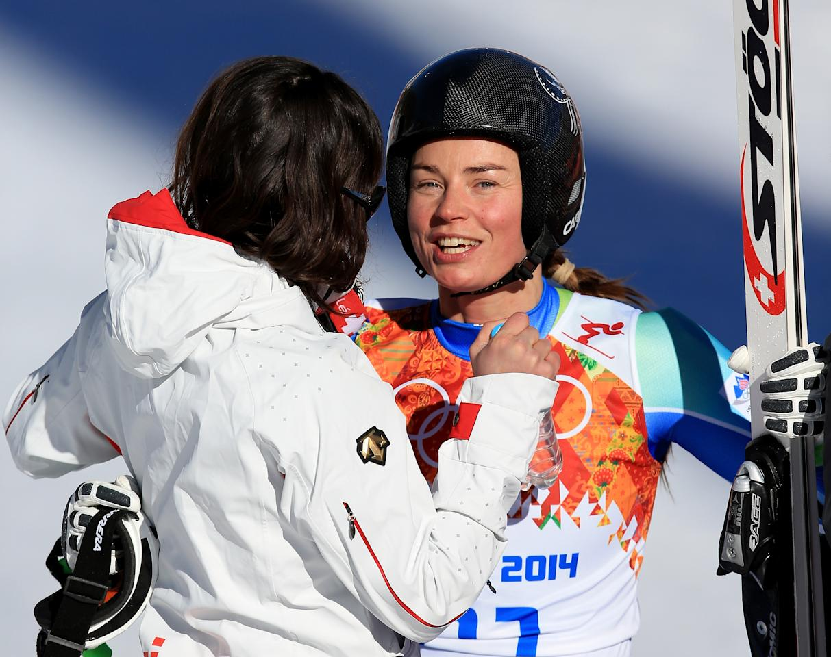 SOCHI, RUSSIA - FEBRUARY 12: Tina Maze of Slovenia (R) speaks to Dominique Gisin of Switzerland after her run during the Alpine Skiing Women's Downhill on day 5 of the Sochi 2014 Winter Olympics at Rosa Khutor Alpine Center on February 12, 2014 in Sochi, Russia. (Photo by Richard Heathcote/Getty Images)