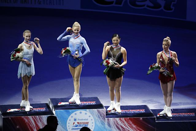 From left, Polina Edmunds, Gracie Gold, Mirai Nagasu and Ashley Wagner pose with their medals after finishing as the top four women at the U.S. Figure Skating Championships in Boston, Saturday, Jan. 11, 2014. (AP Photo/Elise Amendola)