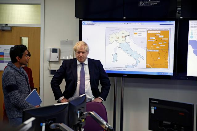 Boris Johnson at the Public Health England National Infection Service in north London on Sunday. (Henry Nicholls)