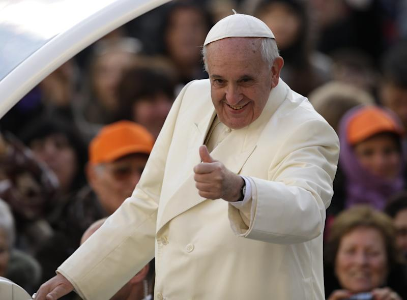 Pope Francis gives the thumbs as he arrives for his weekly general audience, in St. Peter's Square, at the Vatican, Wednesday, Jan. 15, 2014. (AP Photo/Andrew Medichini)