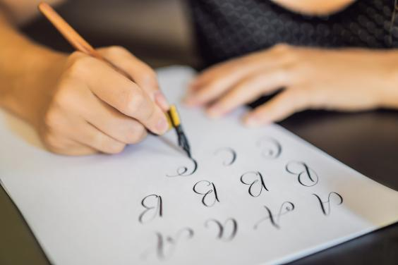 Calligraphy is easy to start, and all you need is a pen and paper – and some ink (Getty)