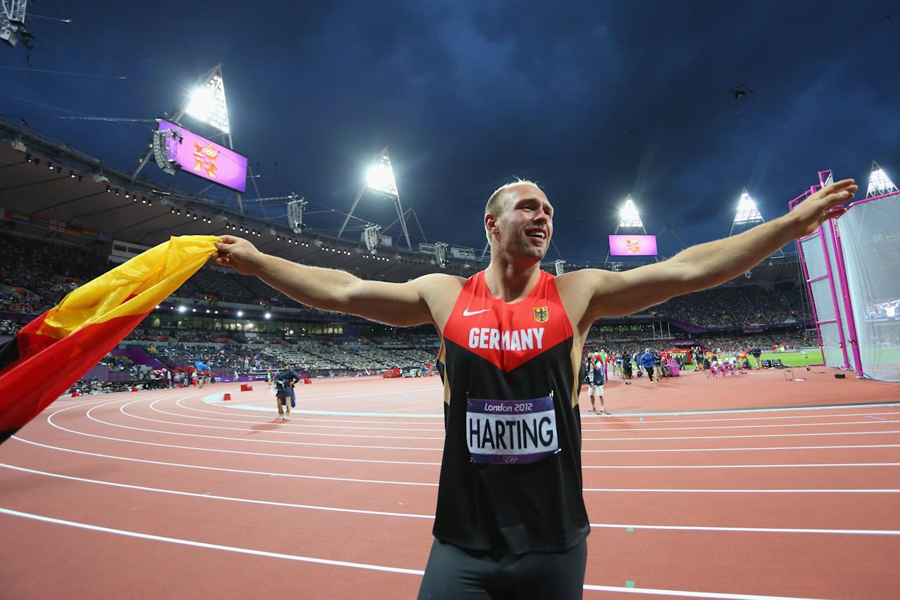 LONDON, ENGLAND - AUGUST 07:  Robert Harting of Germany celebrates winning gold in the Men's Discus Throw Final on Day 11 of the London 2012 Olympic Games at Olympic Stadium on August 7, 2012 in London, England.  (Photo by Alexander Hassenstein/Getty Images)