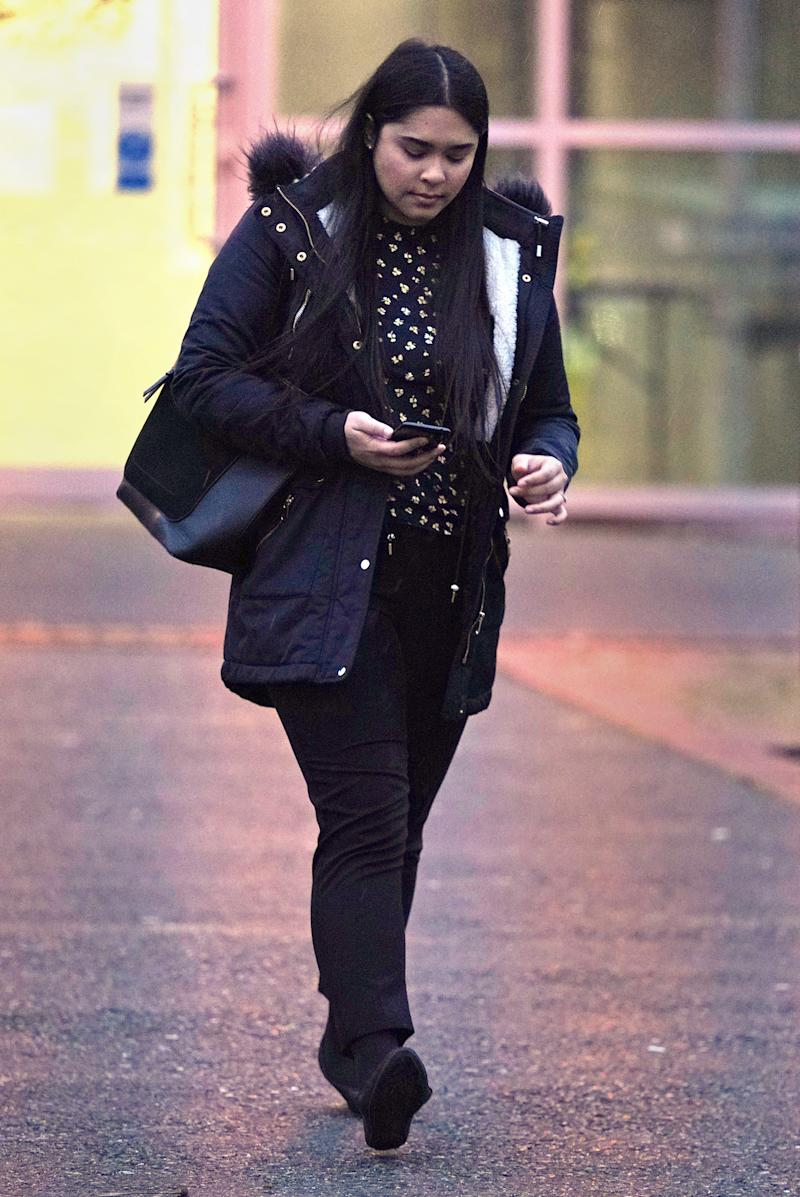 "Sneha Chowdhury leaving Woolwich Crown Court in London, she is accused of terror offences including a plot to ""carry out a mass casualty act"", along with her brother, Mohiussunnath Chowdhury."