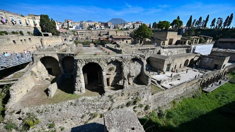 A general view shows the archaeological site of Herculaneum in Ercolano, near Naples, with the Mount Vesuvius volcano in the background