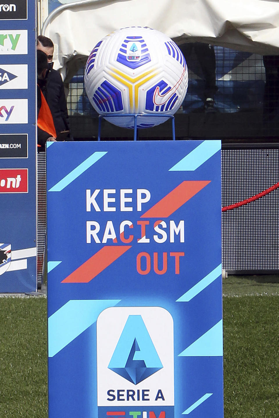 """The logo """"Keep racism out"""", part of the new anti-racism campaign launched last Sunday by the Italian soccer league, is displayed on the field prior to the Serie A match between Sampdoria and Torino at the Luigi Ferraris stadium in Genoa, Italy, Sunday, March 21, 2021. Serie A's efforts to combat racism inside its stadiums was in shambles little more than a year ago when league CEO Luigi De Siervo decided to take matters into his own hands. (Tano Pecoraro/LaPresse via AP)"""