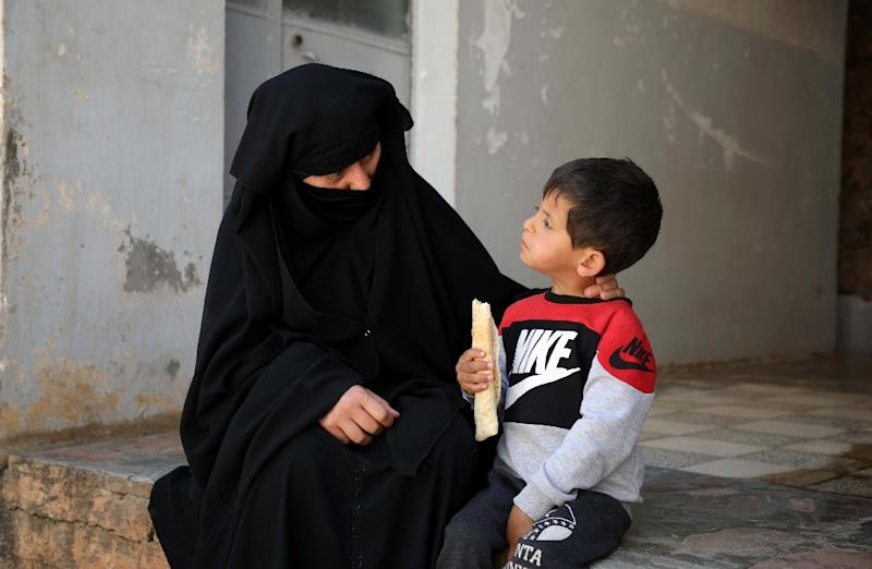 Hasna Dbeis spent four years in regime prisons, where she gave birth to her son Mohammad (AFP Photo/Aaref WATAD)