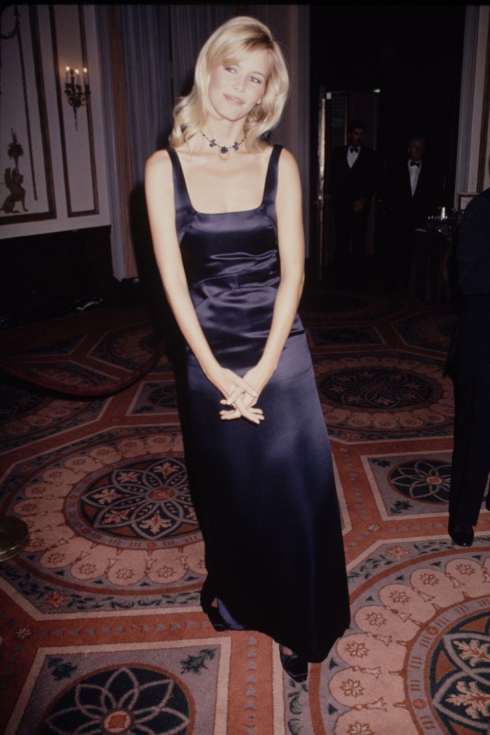 <p>In a navy blue satin gown...</p>