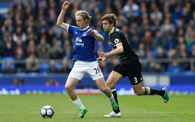 <span>Tom Davies shields the ball from Marcos Alonso</span> <span>Credit: Reuters </span>
