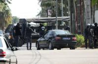 Members of Ivory Coast security forces, surround the residence of former President Henri Konan Bedie, president of the Democratic Party of Ivory Coast (PDCI) in Abidjan