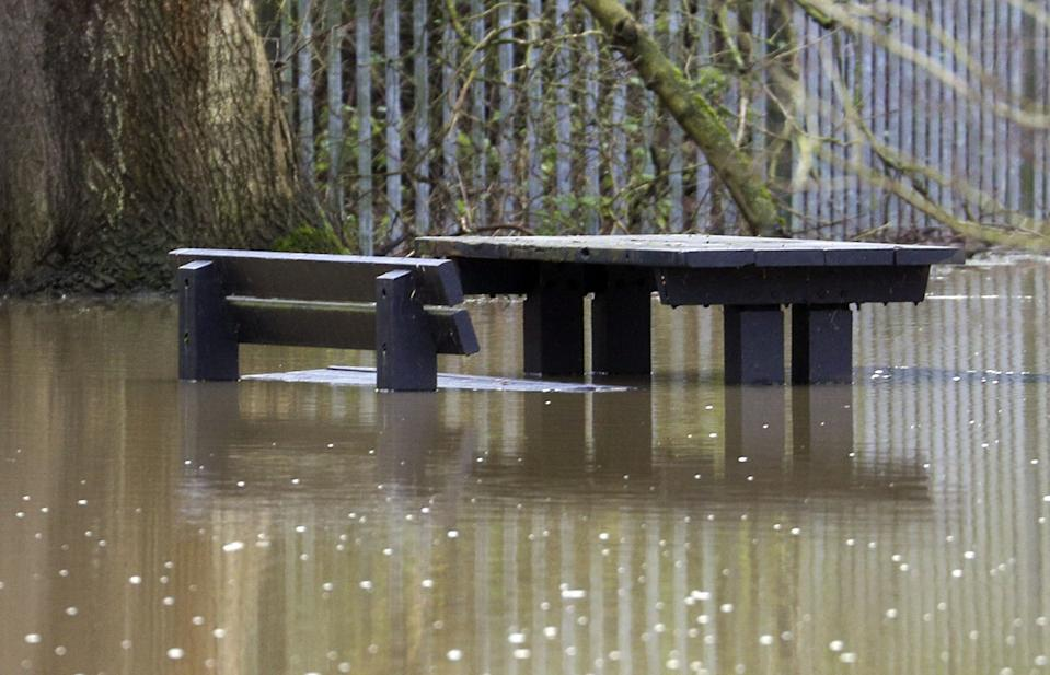 A picnic bench sits in flooded fields next to the River Great Ouse in Haversham, Buckinghamshire. Heavy snow and freezing rain is set to batter the UK this week, with warnings issued over potential power cuts and travel delays. (Photo by Steve Parsons/PA Images via Getty Images)