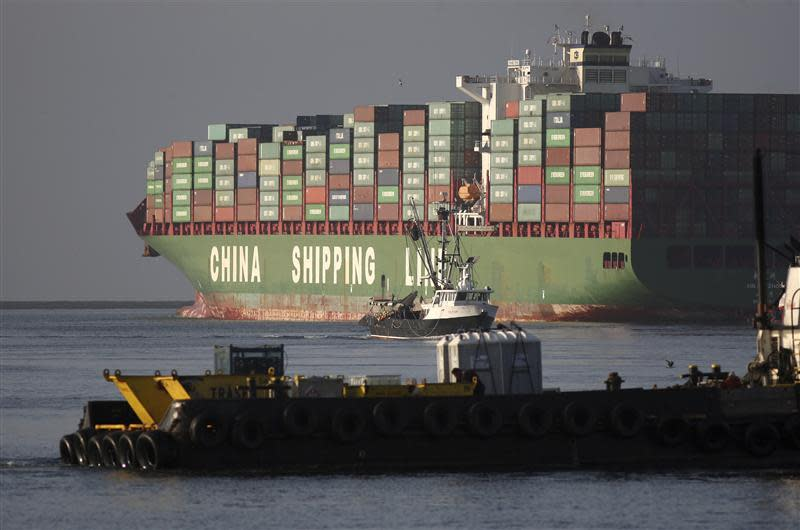 The Xin Mei Zhou container ship is seen at the Port of Los Angeles in Los Angeles