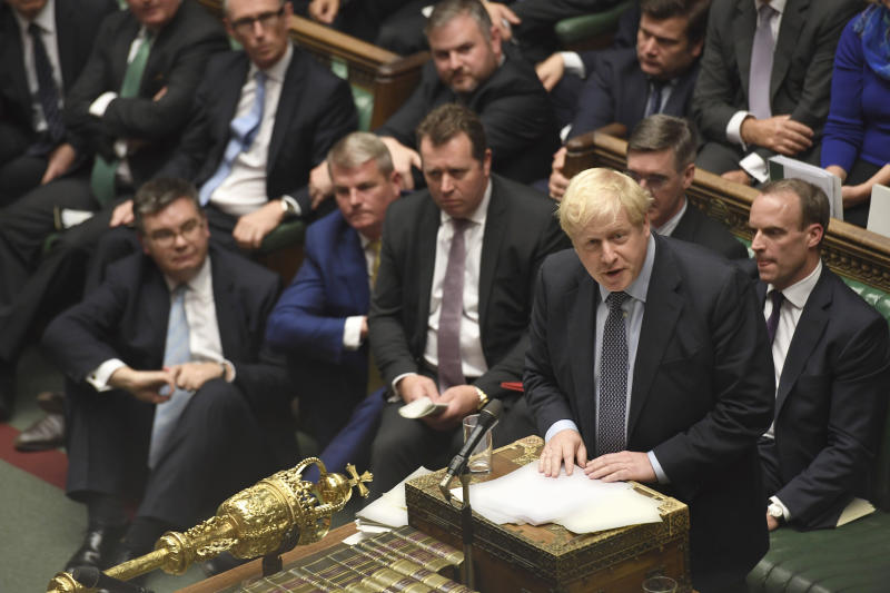 Britain's Prime Minister Boris Johnson speaks during the Brexit debate inside the House of Commons in London Saturday Oct. 19, 2019. At the rare weekend sitting of Parliament, Prime Minister Boris Johnson implored legislators to ratify the Brexit deal he struck this week with the other 27 EU leaders. Lawmakers voted Saturday in favour of the 'Letwin Amendment', which seeks to avoid a no-deal Brexit on October 31. (Jessica Taylor/House of Commons via AP)