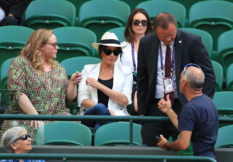 Meghan copped criticism after her security asked a spectator taking a selfie at Wimbledon not to do so. Photo: Getty