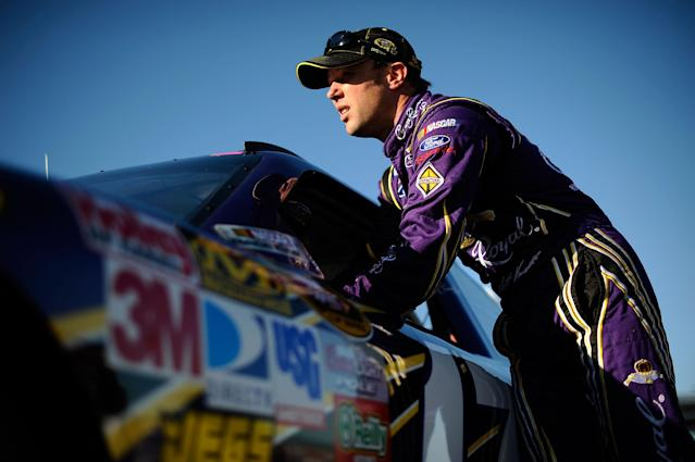 FORT WORTH, TX - NOVEMBER 04: Matt Kenseth, driver of the #17 Crown Royal Ford, stands by his car after qualifying for the NASCAR Sprint Cup Series AAA Texas 500 at Texas Motor Speedway on November 4, 2011 in Fort Worth, Texas. (Photo by Jared C. Tilton/Getty Images for NASCAR)