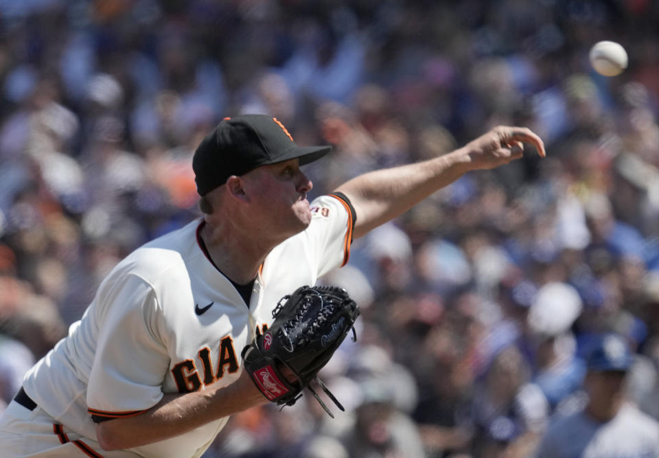 San Francisco Giants relief pitcher Jake McGee throws to a Los Angeles Dodgers batter during the ninth inning of a baseball game Thursday, July 29, 2021, in San Francisco. The Giants won 5-0. (AP Photo/Tony Avelar)