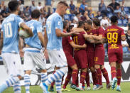 Roma's Aleksandar Kolarov, 4th from right, celebrates with his teammates after scoring on a penalty kick his side's opening goal during the Serie A soccer match between Lazio and Roma, at the Rome Olympic Stadium, Sunday, Sept. 1, 2019. (Claudio Peri/ANSA via AP)