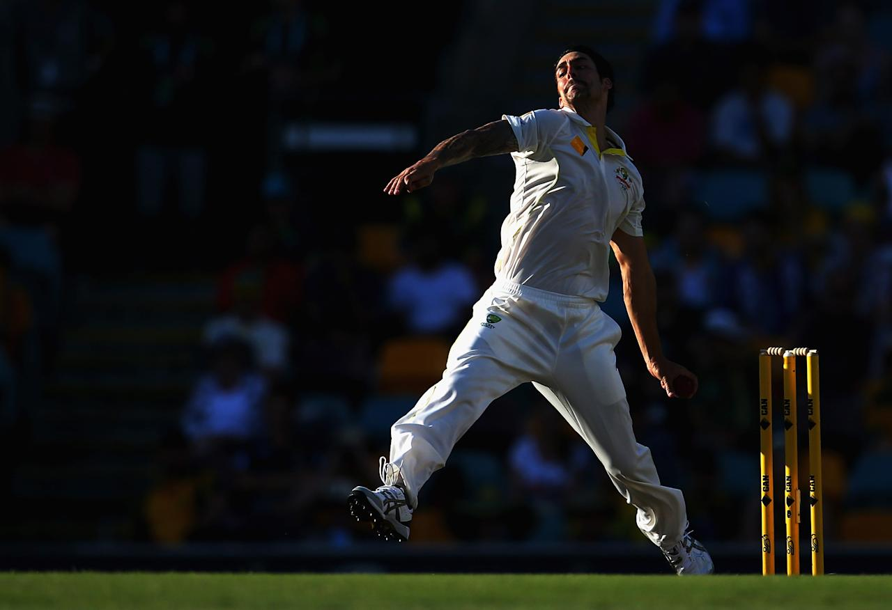 BRISBANE, AUSTRALIA - NOVEMBER 24:  Mitchell Johnson of Australia bowls during day four of the First Ashes Test match between Australia and England at The Gabba on November 24, 2013 in Brisbane, Australia.  (Photo by Ryan Pierse/Getty Images)