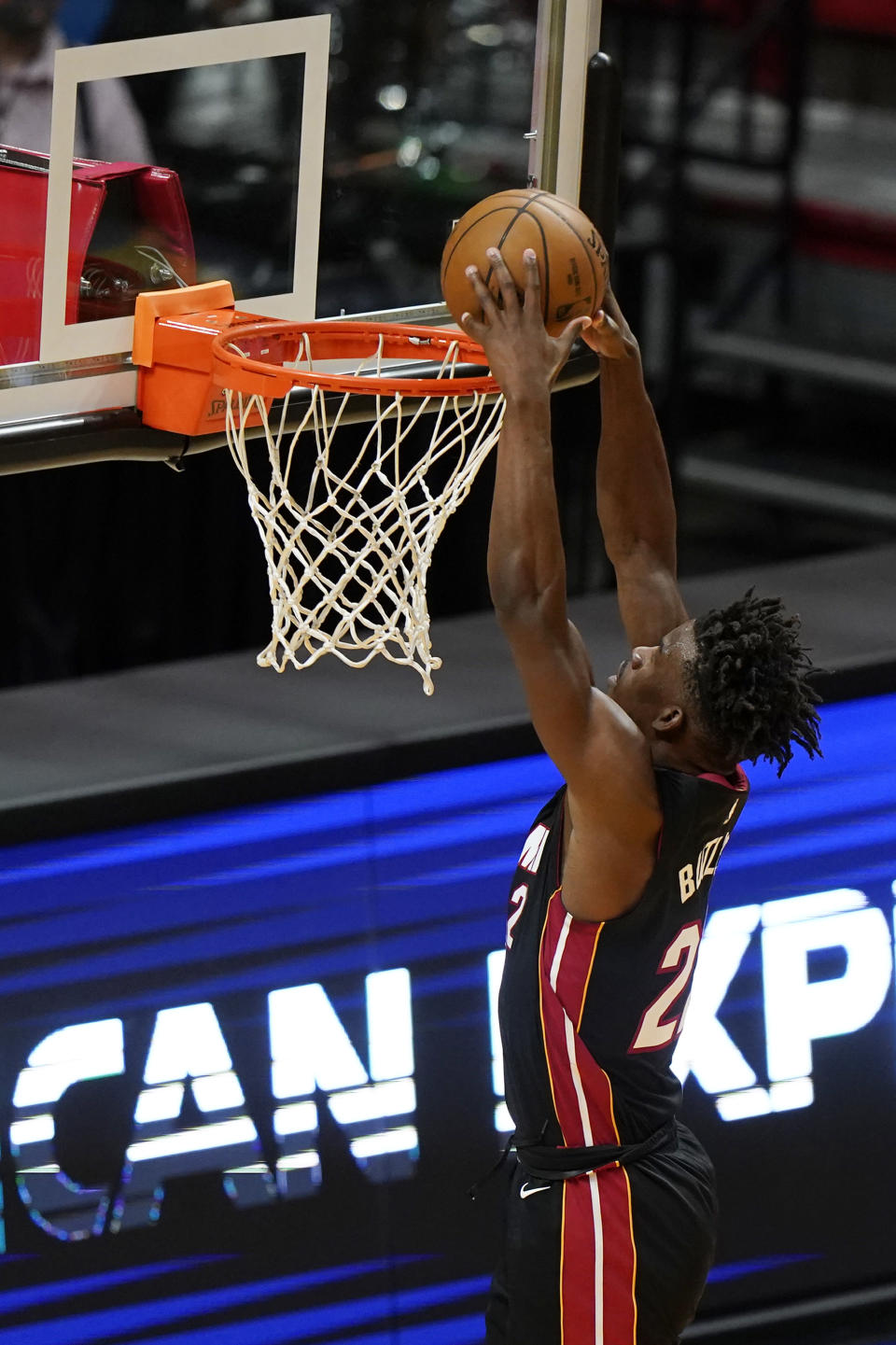 Miami Heat forward Jimmy Butler dunks during the first half of an NBA basketball game against the Minnesota Timberwolves, Friday, May 7, 2021, in Miami. (AP Photo/Wilfredo Lee)