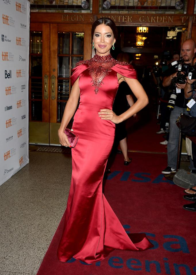 BEST: Canadian actress Sahar Biniaz may not be a household name, but in this va-va-va-voom red dress with its capped sleeve and bejeweled neckline and décolletage, maybe she should be. Yowza!