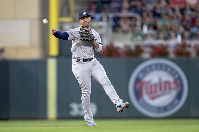 Jul 22, 2019; Minneapolis, MN, USA; New York Yankees shortstop Gleyber Torres (25) throws the ball to first base for an out in the fourth inning against the Minnesota Twins at Target Field. Mandatory Credit: Jesse Johnson-USA TODAY Sports