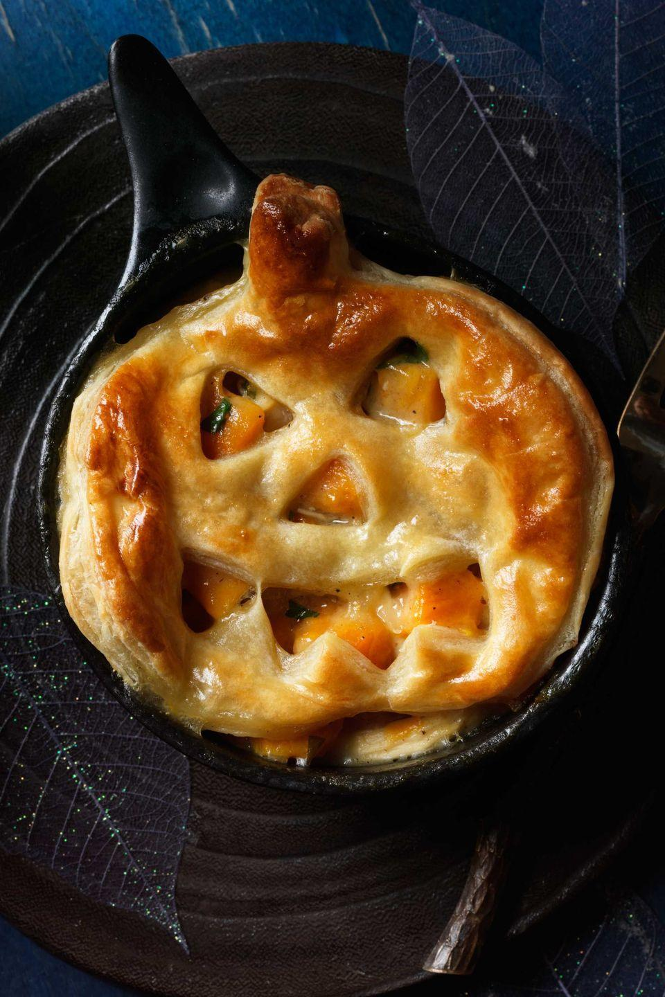 """<p>A frightfully tasty main course for Halloween, this <a href=""""https://www.womansday.com/food-recipes/food-drinks/g1969/sweet-potato-recipes/"""" rel=""""nofollow noopener"""" target=""""_blank"""" data-ylk=""""slk:sweet potato dish"""" class=""""link rapid-noclick-resp"""">sweet potato dish</a> is also a comforting choice throughout winter. Serve it in ramekins as shown, or as one big pie with uncut puff pastry on top, baking until it turns golden.</p><p><strong><em><a href=""""https://www.womansday.com/food-recipes/food-drinks/recipes/a11925/jack-o-lantern-chicken-sweet-potato-potpies-recipe-123644/"""" rel=""""nofollow noopener"""" target=""""_blank"""" data-ylk=""""slk:Get the Jack-o'-Lantern Pot Pies recipe."""" class=""""link rapid-noclick-resp"""">Get the Jack-o'-Lantern Pot Pies recipe. </a></em></strong> </p>"""